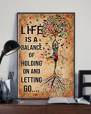 Yoga Life is a balance of holding on  11x17 Poster lifestyle-poster-2