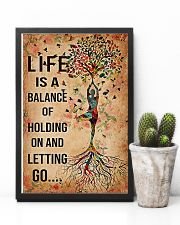 Yoga Life is a balance of holding on  11x17 Poster lifestyle-poster-8