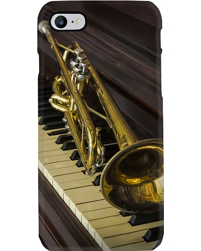 Trumpet On Piano Keyboard
