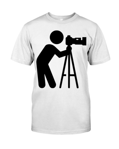 Photographer Stands With Camera