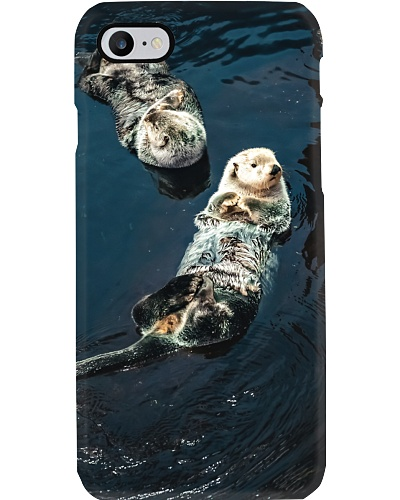 Otters Floating On The Water
