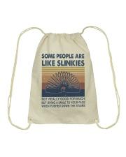 Some People Are Like Slinkies Drawstring Bag thumbnail