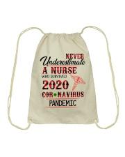 Never Underestimate a Nurse Drawstring Bag thumbnail