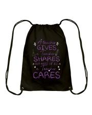 a Teacher cares Drawstring Bag thumbnail