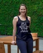 JUST A MOM TRYING NOT TO RAISE A HOLES Ladies Flowy Tank lifestyle-bellaflowy-tank-front-1