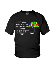 LIFE IS NOT ABOUT WAITING FOR THE STORM Youth T-Shirt thumbnail