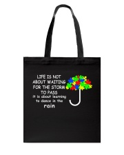 LIFE IS NOT ABOUT WAITING FOR THE STORM Tote Bag thumbnail