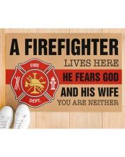 """Firefighter lives here He fears God and his wife Doormat 34"""" x 23"""" aos-doormat-34-x-23-lifestyle-front-03"""