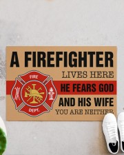 """Firefighter lives here He fears God and his wife Doormat 34"""" x 23"""" aos-doormat-34-x-23-lifestyle-front-06"""
