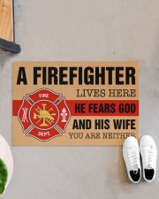 """Firefighter lives here He fears God and his wife Doormat 34"""" x 23"""" aos-doormat-34-x-23-lifestyle-front-07"""