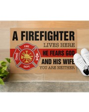 """Firefighter lives here He fears God and his wife Doormat 34"""" x 23"""" aos-doormat-34-x-23-lifestyle-front-12"""
