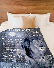 """LIFE MAY SOMETIMES BE DIFFICULT AND UNFAIR Large Fleece Blanket - 60"""" x 80"""" aos-coral-fleece-blanket-60x80-lifestyle-front-02"""