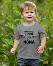 NONA Youth T-Shirt lifestyle-youth-tshirt-front-3