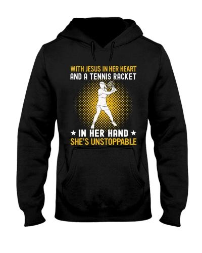tennis in her hand