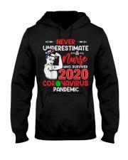 Never Underestimate A Nurse Hooded Sweatshirt thumbnail