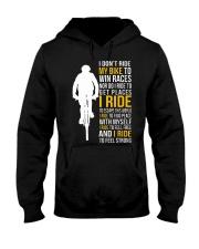 I ride to feel strong Hooded Sweatshirt thumbnail