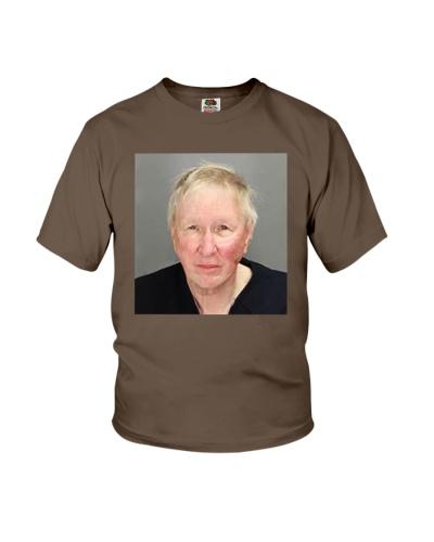 man wipes nose on clerks shirt
