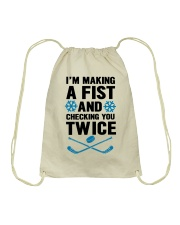 Making a Fist and Checking You Twice Hockey Christ Drawstring Bag thumbnail