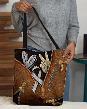 Peace love cure leather pattern print All-over Tote aos-all-over-tote-lifestyle-front-10