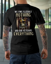 We Owe Illegals And Our Veterans Everything Classic T-Shirt lifestyle-mens-crewneck-back-3