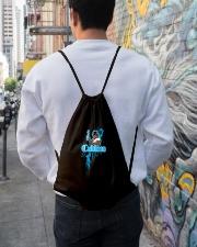 Cudlino Splattered Paint Logo Collection Drawstring Bag lifestyle-drawstringbag-front-1