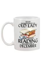 Never Underestimate Old Lady Reading December Mug back