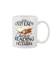 Never Underestimate Old Lady Reading December Mug front