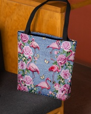 FLAMINGOES AND FLOWER BAG All-over Tote aos-all-over-tote-lifestyle-front-02