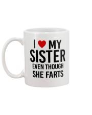 I LOVE MY SISTER EVEN THOUGH SHE FARTS Mug back