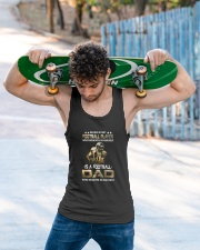 Behind Every Football Player is A Football Dad Unisex Tank apparel-tshirt-unisex-sleeveless-lifestyle-front-02