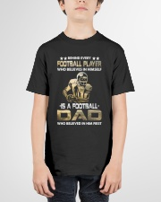 Behind Every Football Player is A Football Dad Youth T-Shirt garment-youth-tshirt-front-01