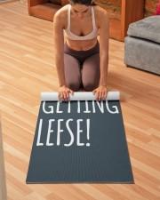 I AM GETTING LEFSE Yoga Mat 24x70 (vertical) aos-yoga-mat-lifestyle-21