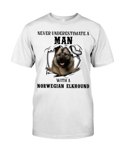 Man With A Norwegian Elkhound