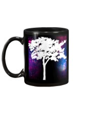 A black cup with a beautiful picture of a tree     Mug back