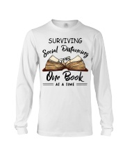 Surviving social distancing one book at a time  Long Sleeve Tee thumbnail