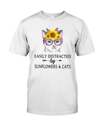 Cat Easily Distracted By Sumflowers   Cats1