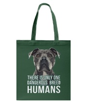 There is only one dangerous breed humans Tote Bag thumbnail