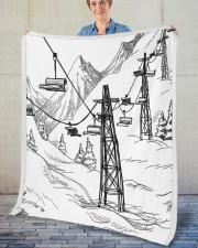 """Skiing blanket 1 Fleece Blanket - 50"""" x 60"""" aos-coral-fleece-blanket-50x60-lifestyle-front-02"""