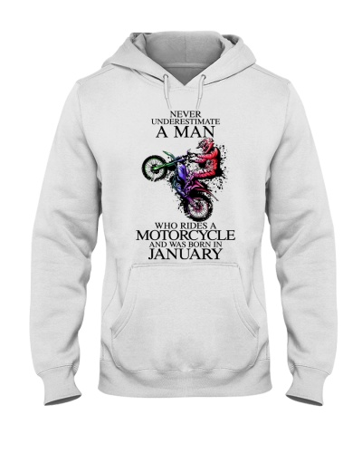 A man rides a motorcycle and was born in January