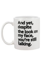 And Yet despite the look on my face Mug back