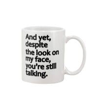 And Yet despite the look on my face Mug front