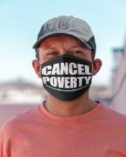 CANCEL POVERTY Cloth face mask aos-face-mask-lifestyle-06