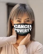 CANCEL POVERTY Cloth face mask aos-face-mask-lifestyle-18
