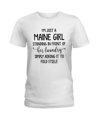 MAINE GIRL STANDING IN FRONT OF HER LAUNDRY