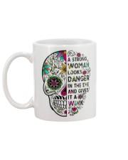 A strong women looks Mug back