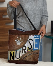 Nurse respect caring courage All-over Tote aos-all-over-tote-lifestyle-front-10