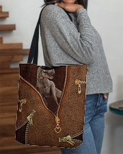 Dinosaur Leather All-over Tote aos-all-over-tote-lifestyle-front-09