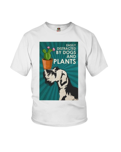 Dog Schnauzer And Plants