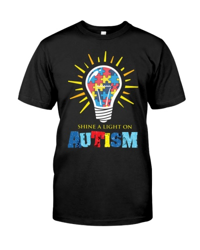 shine a light on autism awareness puzzle piece