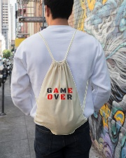It Is Never Game Over Drawstring Bag lifestyle-drawstringbag-front-1